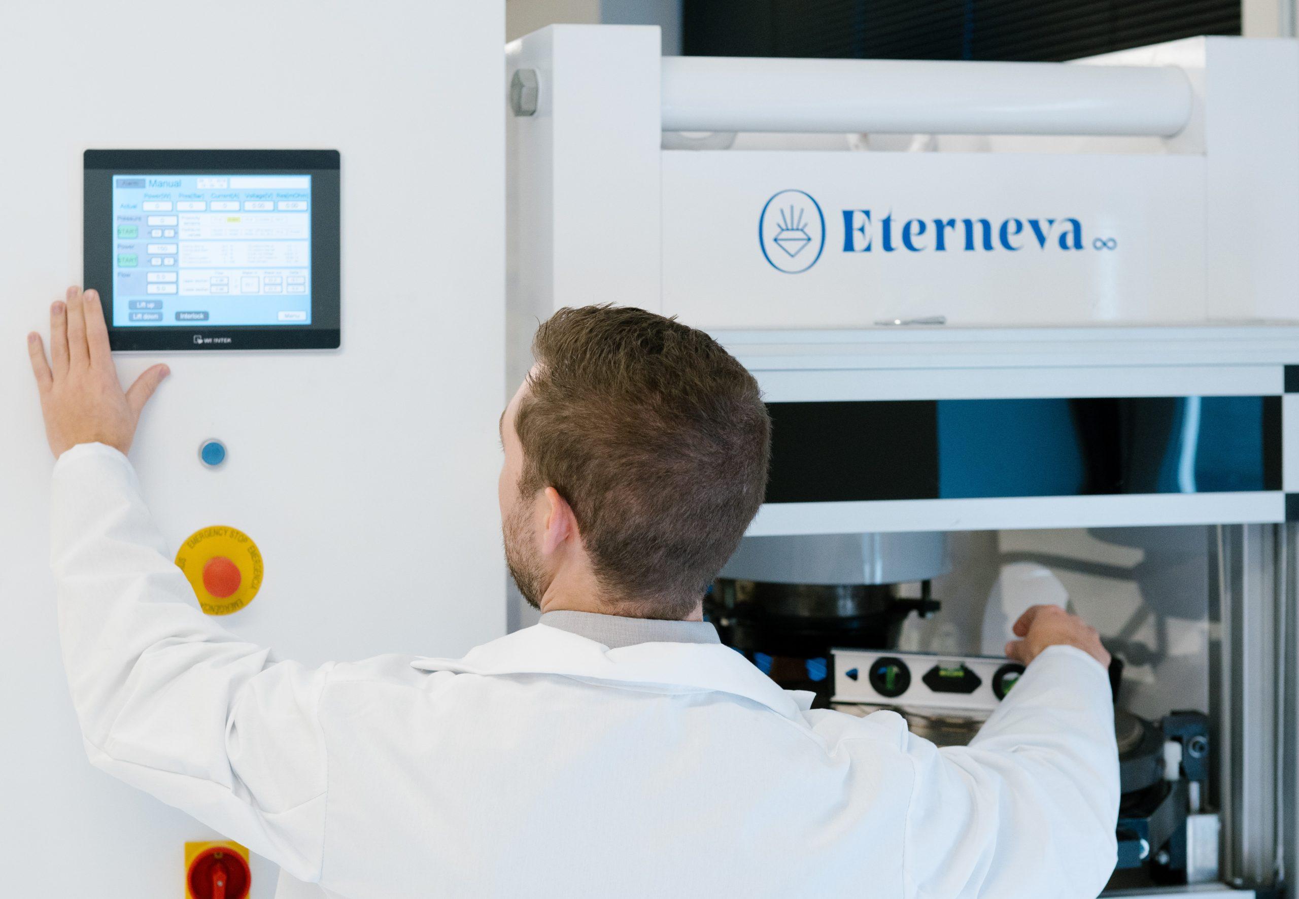 eterneva scientist uses computer console